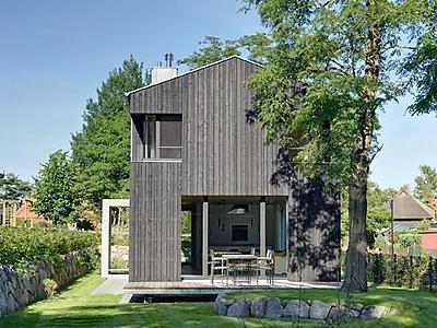 ferienhaus architektenhaus auf dem dar offener wohnbereich mit kamin gro e terrasse in wieck. Black Bedroom Furniture Sets. Home Design Ideas